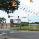 """Figure 13 The African Burial Ground II on the east side of 5th St with Tally auto repair shop now closed and I-64 in the background. This photo and the ones below show no indication that this is a burial ground, hence the term the """"Invisible Burial Ground."""""""