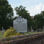 Figure 1 As the marker indicates, some important people are buried in this cemetery